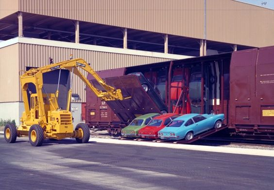 Chevy Vega custom railway car transporter - american innovation to cut shipping costs to bring down price of Vega to market
