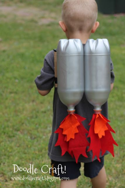 Super Sci-Fi Rocket fueled Jet Pack!  Made with two-litre bottles, silver spray paint, cardboard, straps, and felt.  Orange, red, and yellow flames for the conventional, but could also be blue, green, and yellow, or purple and pink flames!