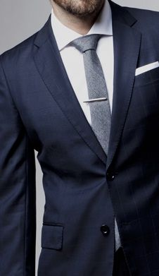 tie & clip & the subtle windowpane in the navy jacket