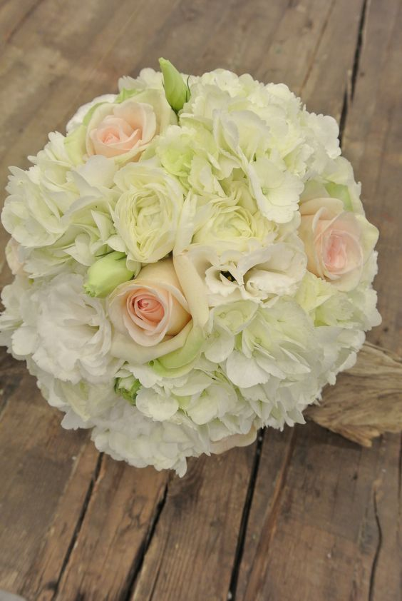 Bridal bouquet with ivory hydrangea, Ranunculus, Lisianthus and roses.