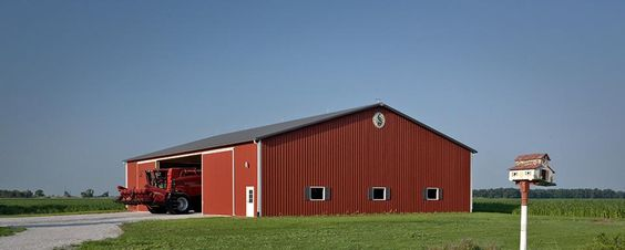 """Farm Building Profile Use: Machine shed for cold storage Size: 70' x 96' x 16'-6"""" post-frame storage shed Building Color: Autumn red Roof & Designer Wall Color: Charcoal"""
