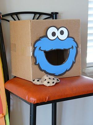 What a great DIY bean bag toss game...try this during center time! Activity Ideas: verbs, counting, turn taking, basic math. For younger kids with physical development needs: move CM's mouth around to encourage shoulder flexion, trunk rotation, crossing midline.
