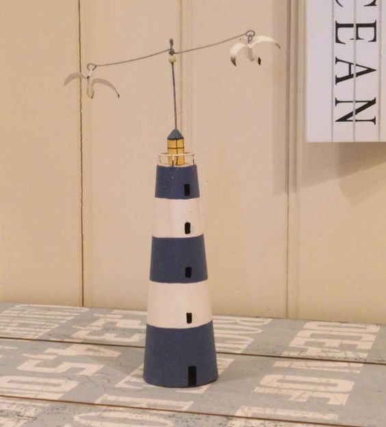 Lighthouse with kinetic seagulls.
