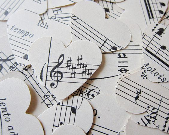 Good idea for a wedding... DI classical sheet music + a heart paper punch + 20 minutes = perfectly cute heart music confetti.