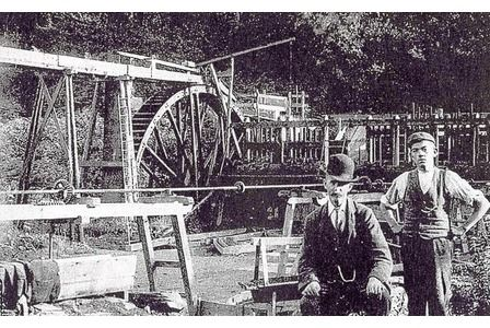 The waterwheel at Atlas Tin Mine in the Bovey Tracey area, around 1900  (Tom Greeves collection)