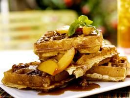 Bobby Flay - sour-cream-waffles-with-fresh-peaches-and-toasted-pecan-praline-sauce-recipe  Oh My wish I could have reached in the tv to eat this today!