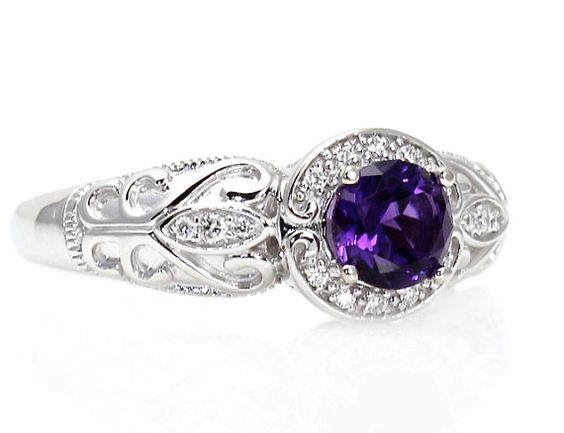 Hey, I found this really awesome Etsy listing at http://www.etsy.com/listing/100049484/14k-vintage-amethyst-engagement-ring