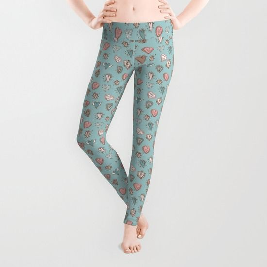 Hand-drawn pink hearts on a blue background Leggings