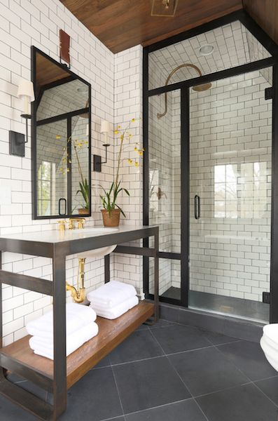 simple bathroom LOVE THE DARK GROUT WITH THE WHITE SUBWAY TILE.: