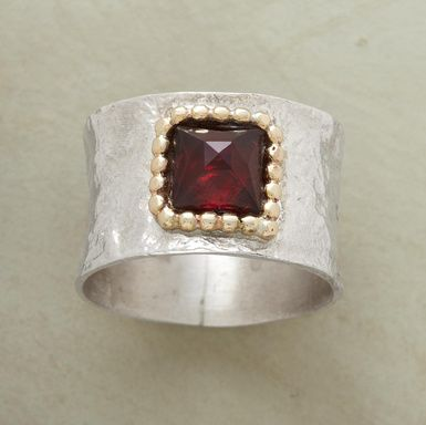Beautifully geometric, a glowing garnet, bezeled in 14kt goldfill, shines squarely on a hammered sterling silver band. Exclusive. Whole sizes 5 to 9.