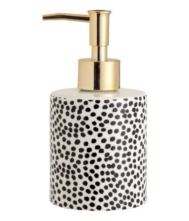 Soap dispenser in porcelain with a printed dot pattern and gold ...