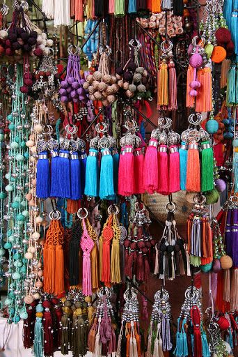 Pompons and tassels in a wonderful display of colour found in Marrakech souk. oh i would go bananas !