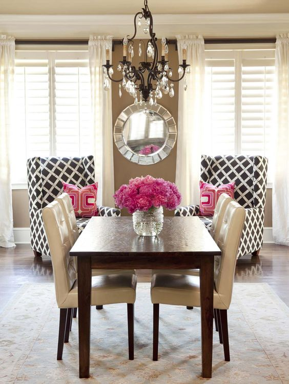 Wood Table with Beige and Black Chairs