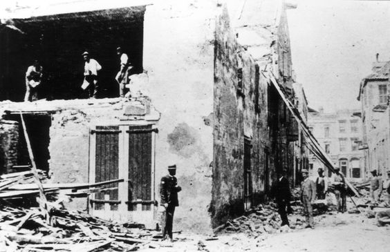 Men look through a warehouse damaged as a result of the earthquake that hit Charleston, SC on August 31, 1886.