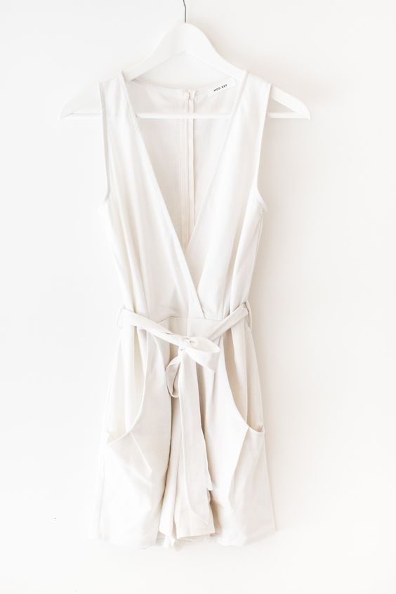 Perfect minimalist romper - a must have for your summer wardrobe! Made with high quality linen-blend material that is non-stretch. Romper is partially lined (on bottom) with a back zipper for easy on