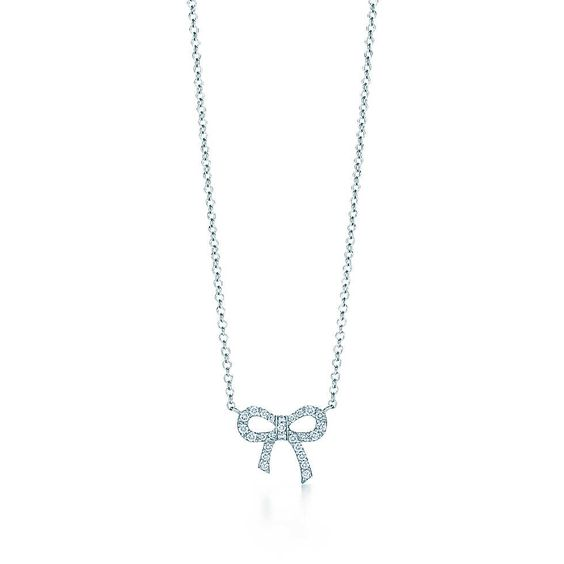 Tiffany Metro bow pendant in 18k white gold with diamonds, mini. Love this so much!