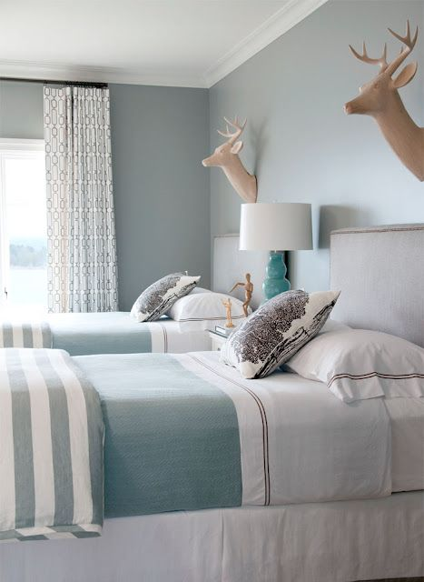 layering bed linens, SO PRETTY! i love the blue and white. might could live without the antlers on the wall
