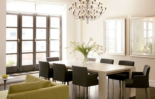 black and white modern minimal dining room with chandeier