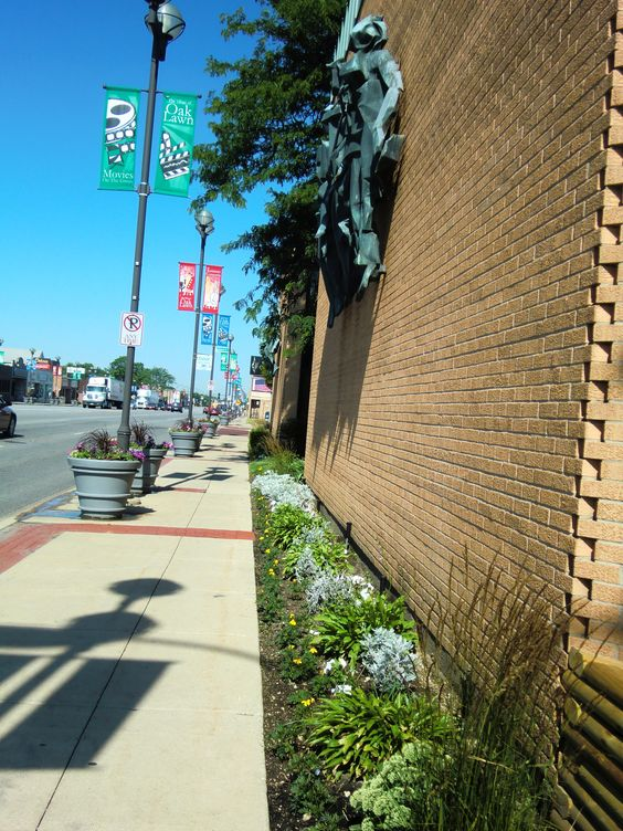 Our sculpture and flowers looking down 95th street towards the west.