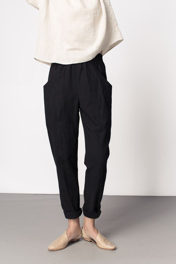 Clyde Work Pant by Elizabeth Suzann. Black slouchy pants with elasticated waist, deep pockets and seam detail. (Made in US):