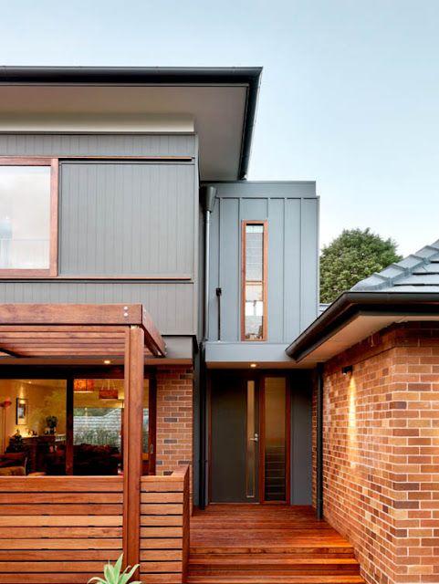 Grey, wood, and brick exterior.