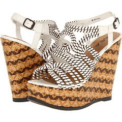 Arrest your feet with intricate texture and ethnic prints as spindly ropes snake across a massive wedge to create this open and exotic sandal! - HighOnShoes.com