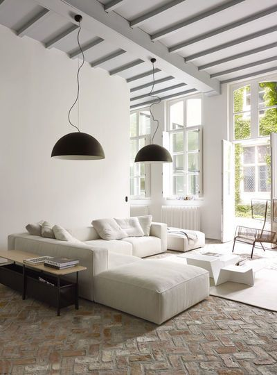 Neutral tone living space with canapé by Ligne Roset. Love that brick ...