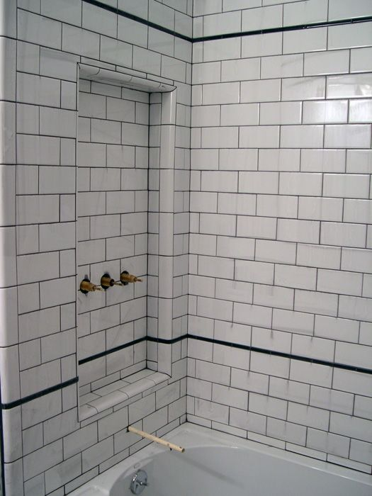 Grout is that thing between tiles that makes them stay together  Though some of you may think it  39 s too non significant to pay attention you are wrong. White subway tile with glass tile decorative band for master