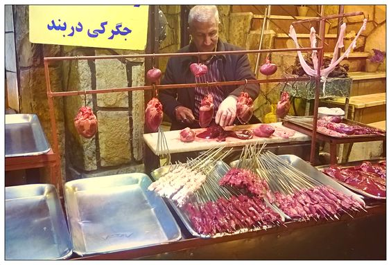 Local Butcher prepares Hearts, Kidneys and Liver for this evening's feast at the restaurant in Darband district of Tehran.