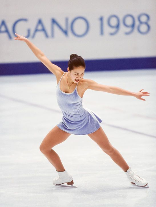 Best Olympic Ice Skating Costume: Michelle Kwan, 1998 Finally, a skater wearing a practical fabric on the ice! Michelle's minimalist periwinkle velvet dress was a welcome change from all the sequins and ruffles.