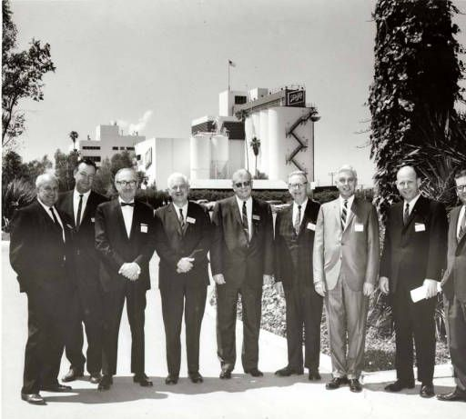 Group portrait outside Schlitz brewery, Van Nuys, California, circa 1950s. In 1982, the Joseph Schlitz Brewing Company was acquired by Stroh Brewing Company of Detroit. Valley Industry and Commerce Association. San Fernando Valley History Digital Library.
