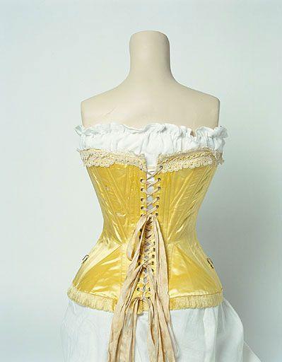Yellow silk satin corset, 1890-1905, back view: