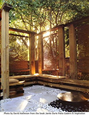 Peaceful outdoor room ~ the bamboo shades can be lowered to filter light & offer privacy yet at the same time maintain a sense of openness to the surroundings.