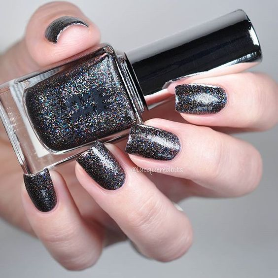 """#Heathcliff is another beauty from @aengland_official #ToEmilyBronte collection. This is a glitter polish in a black base. More info on my blog {link in profile}."" Photo taken by @lacqueredbits on Instagram"