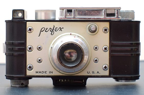 Perfex Speed Candid, 1938. It is the first camera manufactured in the United States to feature a focal plane shutter.
