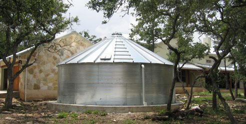 Rainwater collection system used for potable water supply in Hill Country home.  20,000 gallon galvanized metal cistern with internal liner.: