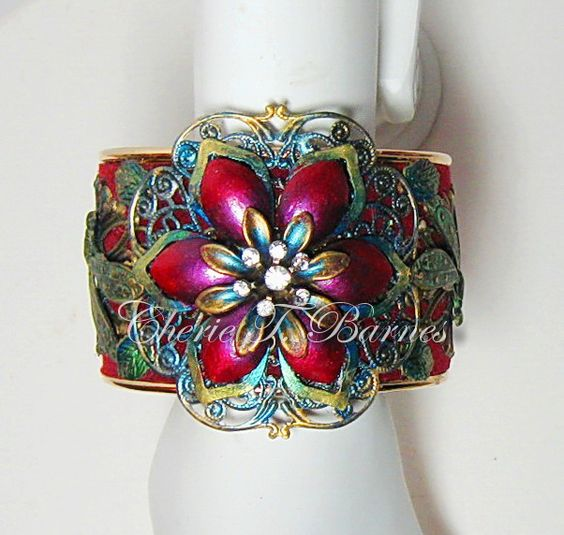 Metal cuff with hand-painted filigree,vertigris dragonflies. Designed and made by Cherie T. Barnes  $60