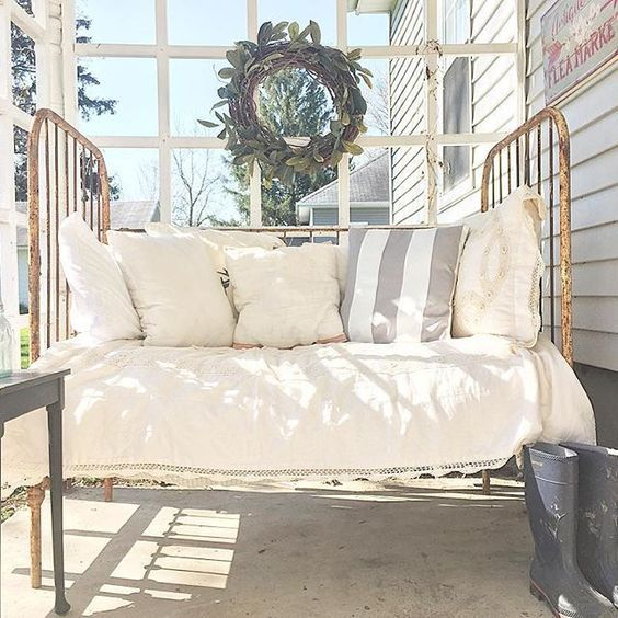 Antique crib turned porch daybed eclecticallyvintage.com