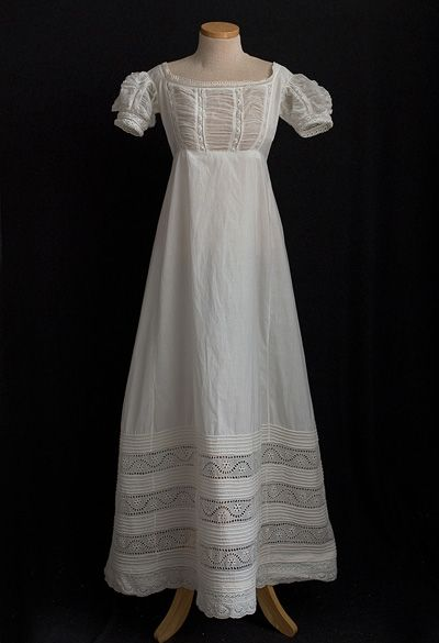 'This dainty dress anticipates the change from the Neoclassical to the Romantic period. The waist is still high as in the Empire style, but the skirt is flared and fuller.'