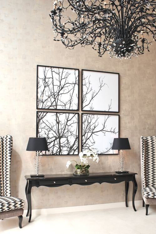 Gorgeous black and white space. Perfect table, decor, and those wing back chairs!