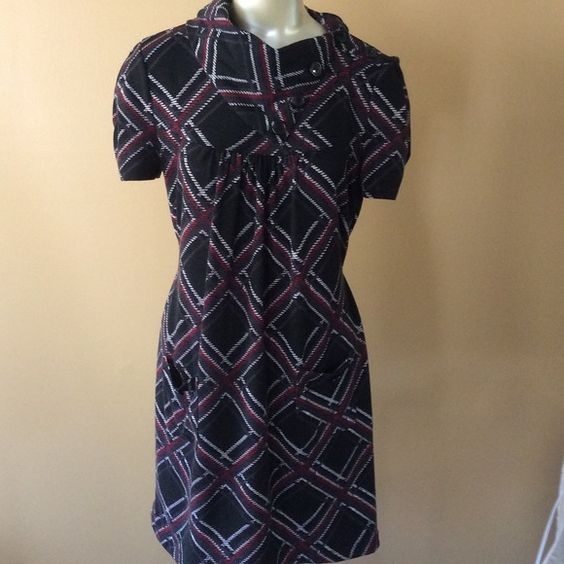 Dress Cute dress, perfect for casual like look. Slips over head, front pockets, 96% polyester, 4% spandex, ties in back. Dresses Midi