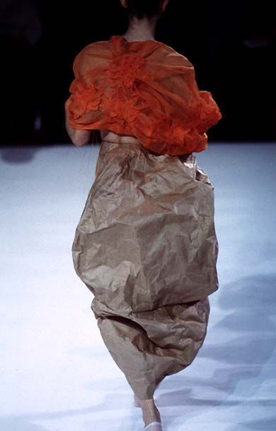 Rei Kawakubo/Comme des Garcons SS 1997 http://firstview.com/collection.php?p=16&id=2456&of=23 The use of a crinkled surface and voluminous silhouette really play with light and form. There is no clear indication of where the body ends and the garment begins, playing with the space in between.