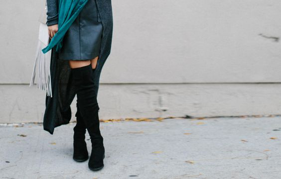 A Beginner's Guide to Wearing Skirts with Boots. The length of the skirt and the height of the boots can make or break your look. #stylehowto