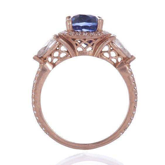 My actual engagement ring (profile view), designed by CIMELIO JEWELRY! It is beyond gorgeous, a truly special and unique heirloom (or will be, in a few years!).  A 3.18ct unheated Ceyloni sapphire surrounded by a halo of round brilliant cut diamonds and flanked by 0.50cts of pear shape rose-cut diamonds in 14kt rose gold.