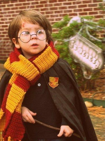 Adorable little Harry Potter cosplay child all costume ready