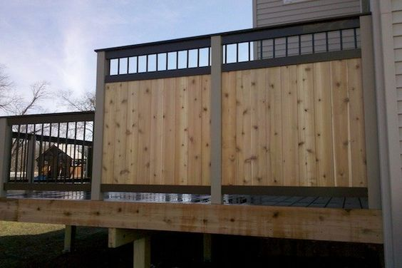 Trex and Wood Privacy Wall on Trex Deck in Lake County built by Rock Solid Builders, Inc.