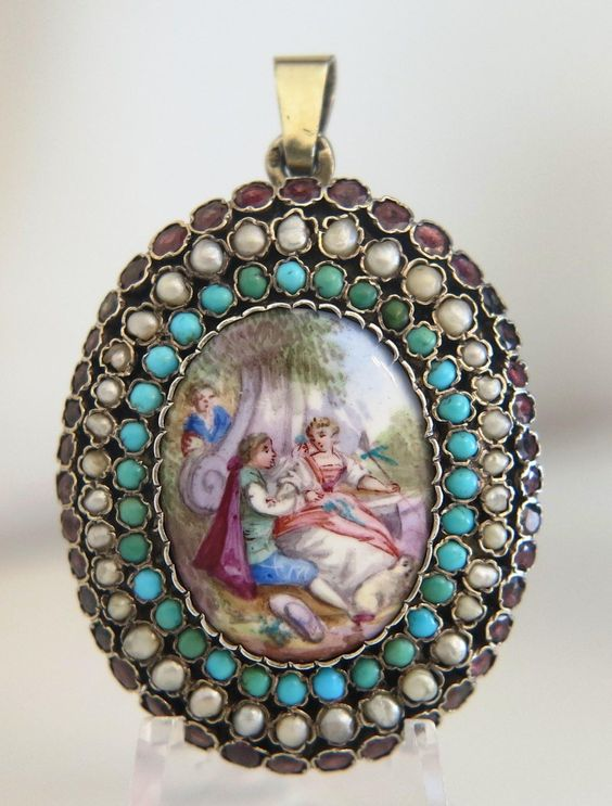 Pendant with a fine crafted Viennese Enamel plaque in the center depicting an Arcadian scene. The Enamel plaque is surrounded by turquoise, seed