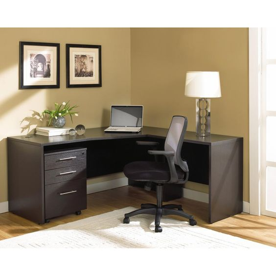 This commercial grade work station feature a large 5' desk with a side return and a filing cabinet on castors. The set is made of durable wood