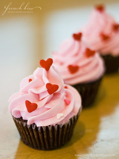 Pink Valentines Day cupcakes with heart sprinkles!: