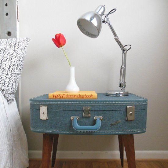 From trash to treasure: $1 suitcase and a free mid century table make up this fun vintage piece.